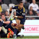 Aaron Smith of the Highlanders passes the ball during the round eight Super Rugby match between...