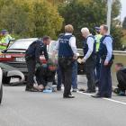 Police arrest three men in Dunedin yesterday after a high-speed pursuit on the Southern Motorway....