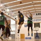 Bombers swingman Steve Robinson shoots over Saints guard James Ross as Damon Cleverley (12) and Henrie Njob-Anti (13) look on at Saturday's pre-season blitz tournament at the Edgar Centre. Photo by Gregor Richardson.
