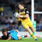 Hurricanes first five-eighth Beauden Barrett beats his Blues opposite Piers Francis during the...