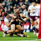 Ben Matulino offloads the ball for the Warriors last year against Manly. The prop is heading to...