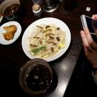 A customer takes pictures of an 'Insect tsukemen' ramen noodle topped with fried worms and crickets