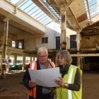 Simon Currant & Associates principal Simon Currant and Mondelez International Dunedin site manager Judith Mair look over the plans for the Cadbury World development in the plant's old dairy building. Photo by Gregor Richardson.