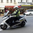 Dunedin City Council parking officer Bevan Mears wears a body camera in George St yesterday....