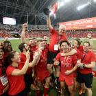 The Canada team celebrates after winning the Singapore Sevens. Photo: Getty Images