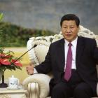 China's Vice President Xi Jinping speaks with Egypt's President Mohamed Mursi during a meeting at...