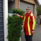 Joan Paul delivers a letter to a Palmerston letterbox on her last delivery day last Friday. Photo...