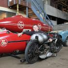 Southland Motorcycle Club member Stephen Winteringham sits between the motorcycle which was made...
