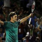 Roger Federer of Switzerland celebrates after winning match point against Nick Kyrgios of...