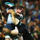 Angus Cottrell of the Force lifted Sam McNicol of the Chiefs in a tackle during the game. Photo:...