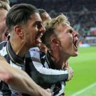 Newcastle players celebrate after Matt Ritchie (R) scored from the penalty spot against Preston....