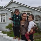 Standing outside their future home in Tainui are  Ki'anie Pikia, her son Galaxie (3, left) and...