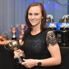 Otago Sparks player Katey Martin with one of the awards she received at the Otago cricket awards...