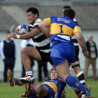 Southern No8 Mika Mafi charges forward during a match against Taieri at Bathgate Park last...