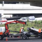 A McLaren supercar is loaded onto a recovery truck after an accident on the Great North Road on-ramp onto the Northwestern Motorway in Auckland. Photo: NZ Herald / Peter Meecham