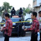 Policemen keep watch on the perimeter of a scene where a leader of the Beltran Leyva cartel was...