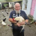 Animal lover and Herbert local Wayne Richardson holds one of his flock. Photo by Shannon Gillies.