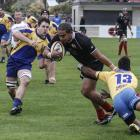 Old Boys centre Omega Masoe tries to fend off his opposite number, Matthew Vocea, of Valley,...