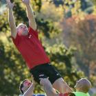 Scott Allison takes lineout ball with the assistance of  Hua Tamariki (left) and Lyal Bayliss...