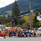 A Delta crew work on a power pole in Frankton Rd yesterday. Photo: Guy Williams.