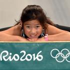Gymnast Yui Ishikawa (9) shows off the Dunedin Gymnastic Academy's  new equipment at the gym in...