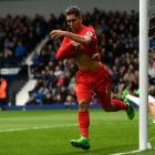 Roberto Firmino celebrates his goal that gave Liverpool a 1-0 win over West Brom. Photo: Getty...