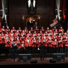 The Dunedin Returned Services Choir Anzac Revue, under the direction of Karen Knudson, starts in the Dunedin Town Hall with Sound Ye Trumpets and guest trumpeter Ralph Miller. Photo: Gregor Richardson.