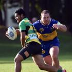 Green Island fullback Sunia Makasini is about to be tackled by Taieri prop Guy Millar during a Dunedin premier club rugby match at Peter Johnstone Park last Saturday. Photo by Peter McIntosh.