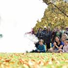 """More than 200 people watch as science communicator Amadeo Enriquez-Ballestero creates a """"storm'' using liquid nitrogen and boiling water at the Dunedin March for Science on the Museum Reserve on Saturday. Photo: Peter McIntosh."""
