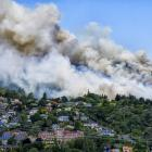 A huge smoke cloud rises from the fire at Signal Hill yesterday,  taken from Fortune St, Dalmore....