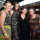 Getting set to board a train at Dunedin Railway Station to the Middlemarch Singles Ball on Saturdayare (from left) Tegan Erickson (26), of Invercargill, Lauren Smith (28), of Edinburgh, Samantha Maxwell (25), of Invercargill, and Jane McMecking (25), of D