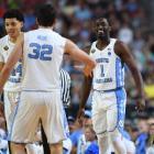 North Carolina players Justin Jackson, Luke Maye and Theo Pinson celebrate after beating Oregon...