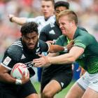 Vilimoni Koroi tries to break a tackle during New Zealand's loss to South Africa in Hong Kong....