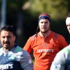 Highlanders lock Joe Wheeler at training at Logan Park this week. In front of him are (from left)...