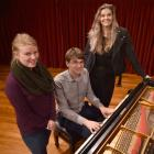 University of Otago singers Erica Paterson (left), Nathaniel Otley and Rhiannon Cooper rehearse in Marama Hall after being selected for the New Zealand Youth Choir. Absent: Matariki Pakaua and Benedict Tan. Photo by Gregor Richardson.