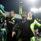 Chelsea manager Antonio Conte celebrates with his players after they secured the Premier League...