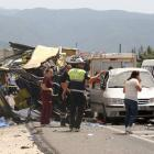 Medics and rescue workers at the crash scene. Photo Reuters