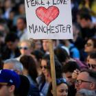 People attend a vigil for the victims of the Manchester Arena attack. Photo: Reuters.