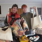 Clutha Change Collective members Dianne Schnarr (left) and Denise Dent show off the bags they...