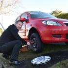 Midway Motors managing director Chris Henderson fits a new wheels and tyres to Alwyn Isaacs'...