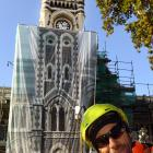 Adgraphix sales consultant Jono Gallacher in front of the clocktower after it was covered by a...
