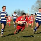 Clutha fullback Tyler Bichan dives over the tryline in the South Otago club final against Heriot...
