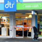 A passer-by takes a closer look, as police tape covers the entrance to DTR's South Dunedin store...