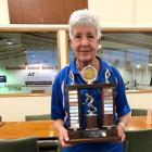 Eileen Grant (South Otago) holds the Sandra Gould Trophy for being the player of the tournament...