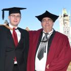 Father and son graduands Liam and Tim Ferner at the Otago campus. Tim Ferner exposed a...