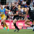 Simon Mannering runs the ball up for the Warriors against the Eels in an NRL match in Auckland...