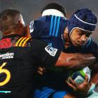 Gerard Cowley-Tuioti on the charge for the Blues against the Chiefs. Photo Getty