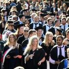 Graduands march down George St towards the Dunedin Town Hall where two University of Otago...