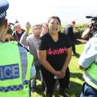 Activists outside the National Party conference at the Waipuna Conference Centre today. Photo: NZ...