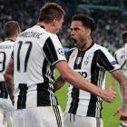 Mario Mandzukic and Dani Alves celebrate a Juventus goal during their Champions League semifinal...